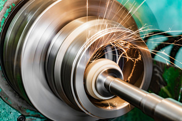 Metal grinding, internal grinding with an abrasive wheel on a high-speed spindle of a circular grinding machine. Wall mural