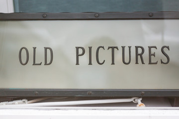 """old high quality sign saying """"old Pictures"""""""