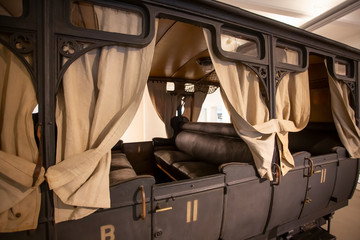 vintage military carriage with curtains and leather seats