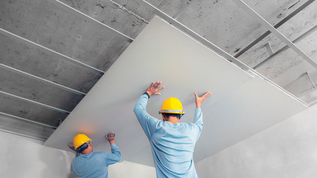 Ceiling installation with acoustic panels With professional technicians