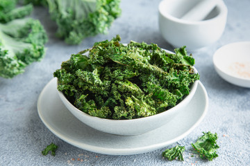 crispy kale chips in bowl, healthy vegan food