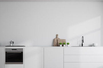 White countertops in white kitchen