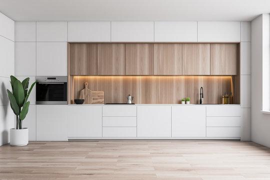 Minimalistic white kitchen with oven