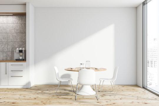White kitchen interior with round table