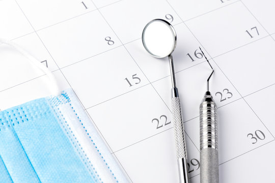 Reminder dentist appointment in calendar and professional dental tools.