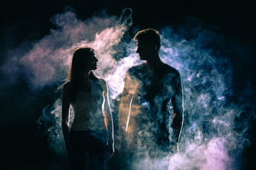 The silhouette of couple in the smoke