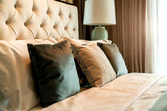 close up white beige soft pillows on bed and blanket bedroom interior design concept.bed maid luxury ideas concept