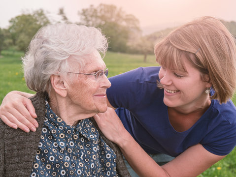 Happy senior woman together with young woman