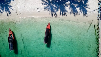 A long tail boat anchor to Koh Touch Beach on Koh Rong with palm tree shadows, Cambodia Fototapete