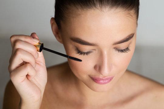 Doing Makeup. Woman Applying Mascara on Eyelashes
