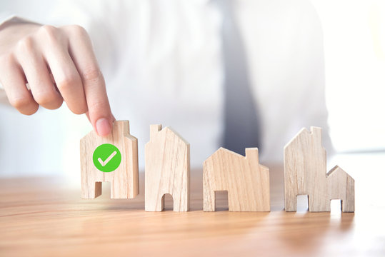 Businessman choosing house model with icon check mark, Choose what's the best, Planning buy Real Estate.