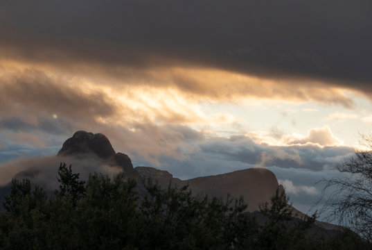 Thee sun sets over Sombrero Peak in Tucson AZ