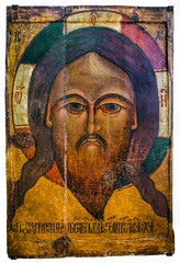 Old Russian Orthodox icon of Christ of the 12th century. Made in the ancient encaustic technique on a wooden frame. Irkutsk, Russia. Isolated on white background.