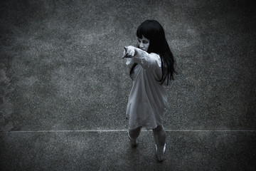 Woman ghost horror under building house point finger to your face,