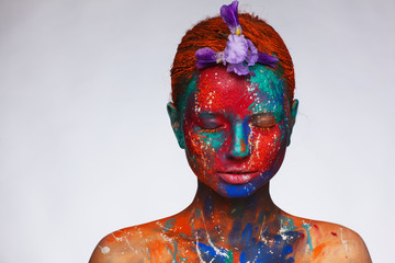Papiers peints Carnaval Creative fantastic makeup using colorful paints on the model