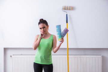 Young beautiful woman doing renovation at home