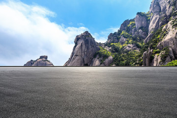 Asphalt road and beautiful mountain nature landscape in Huangshan,Anhui,China. Wall mural