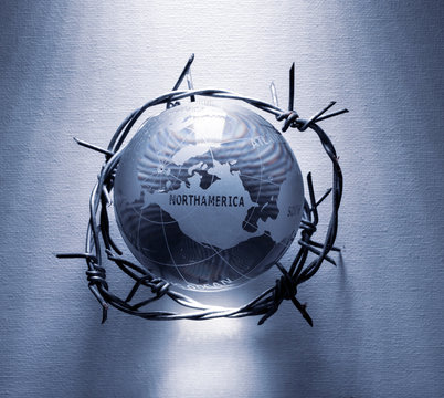 Globe wrapped in barb wire