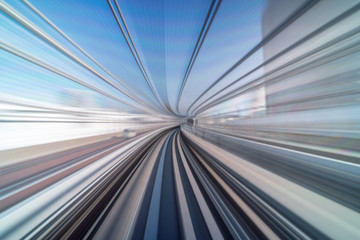 Furistic scene Motion blur movement from tokyo japan train of Yurikamome Line moving between tunnel in Tokyo, Japan