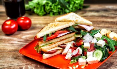 Light summer quick Breakfast , ham sandwich and fresh salad .