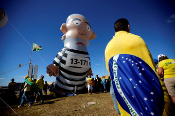 "An inflatable doll, depicting former Brazilian president Luiz Inacio Lula da Silva is seen during a protest against corruption, in favour of the ""Car Wash"" investigation and the Brazil's Justice Minister Sergio Moro"