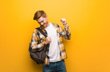 Young redhead student man dancing and having fun