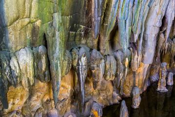 Foto auf Leinwand Fantasie-Landschaft stalagmite stones hanging on the ceiling of a drip cave, beautiful underground scenery