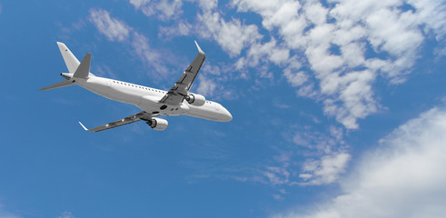Airplane flying in the blue sky,