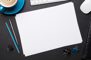 Fototapeta Office workplace table with blank paper page obraz