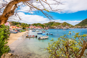 Wall Mural - Landscape with small beach and bay with boats. Terre-de-Haut, Les Saintes, Iles des Saintes, Guadeloupe, French Antilles, Caribbean.