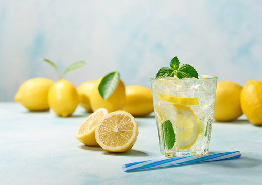 Lemonade with lemon and mint, cold refreshing drink . Healthy and detox water drink.