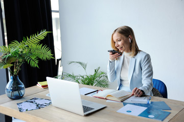 Woman top manager dictates voice message