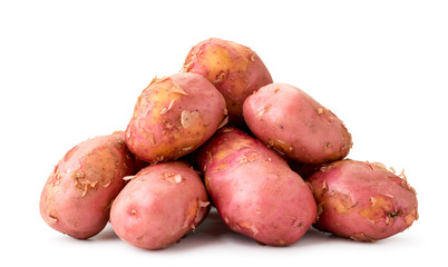 Pile of young pink potatoes close up on a white background. Isolated.