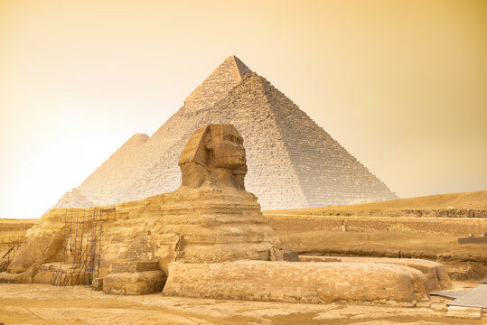 Sphinx and pyramids at sunset