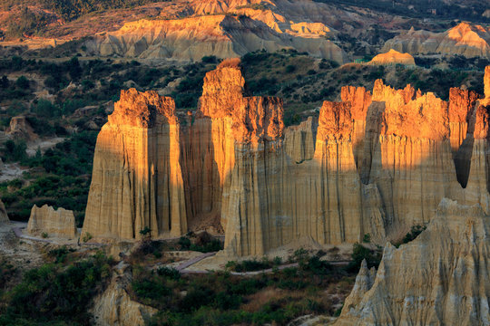 Earth Forest of Yuanmou in Yunnan Province, China - Exotic earth and sandstone formations glowing in the sunlight. Naturally formed pillars of rock and clay with unique erosion patterns. China Travel