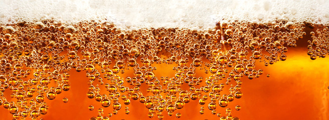 Beer detail.Cold lager beer drink with bubbles and drops