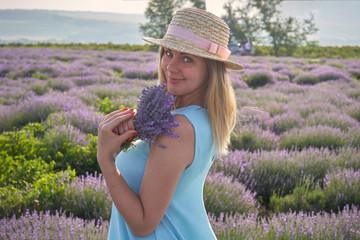 cute woman standing on a beautiful lavender field