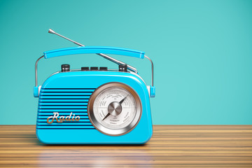 Vintage blue radio receiver on wood table. Wallpaper 3d