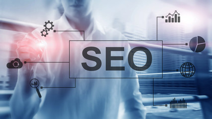 SEO - Search engine optimization, Digital marketing and internet technology concept on blurred background.