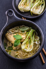Thai green curry chicken soup with pak choi