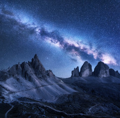 Wall Mural - Milky Way over mountains at starry night in summer. Amazing landscape with alpine mountains, blue sky with milky way and stars, high rocks. Tre Cime in Dolomites, Italy. Space. Beautiful nature