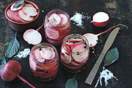 Fermented radish in jars. Cooking fermented vegetables. Probiotics.