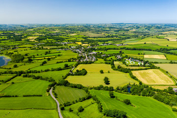 Aerial drone view of green fields and farmland in rural Wales Wall mural