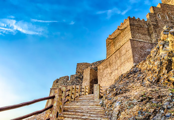 Stone staircase to the famous Muttrah Fort with blue sky background. From Muscat, Oman.