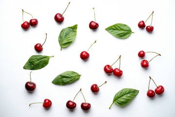 Fresh ripe cherry pattern background. Creative summertime fruit layout. Healthy food, delicious dessert