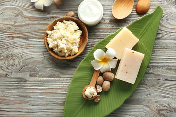 Composition with shea butter on wooden background