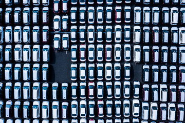 New ready to export cars in a parking lot from above