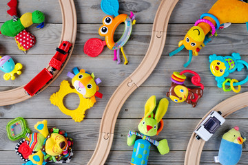 Many toys on wooden table. top view Wall mural