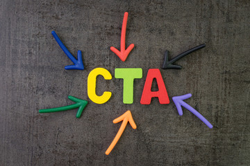 CTA, Call to action in advertising and communication concept, multi color arrows pointing to the word CTA at the center of black cement chalkboard wall