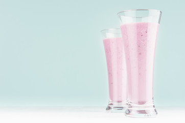 Autocollant pour porte Lait, Milk-shake Set of two diet milk beverages with blueberry in elegant glass on pastel soft light blue background, copy space.